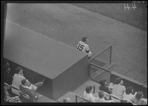 Athletics player no. 35 on dugout steps