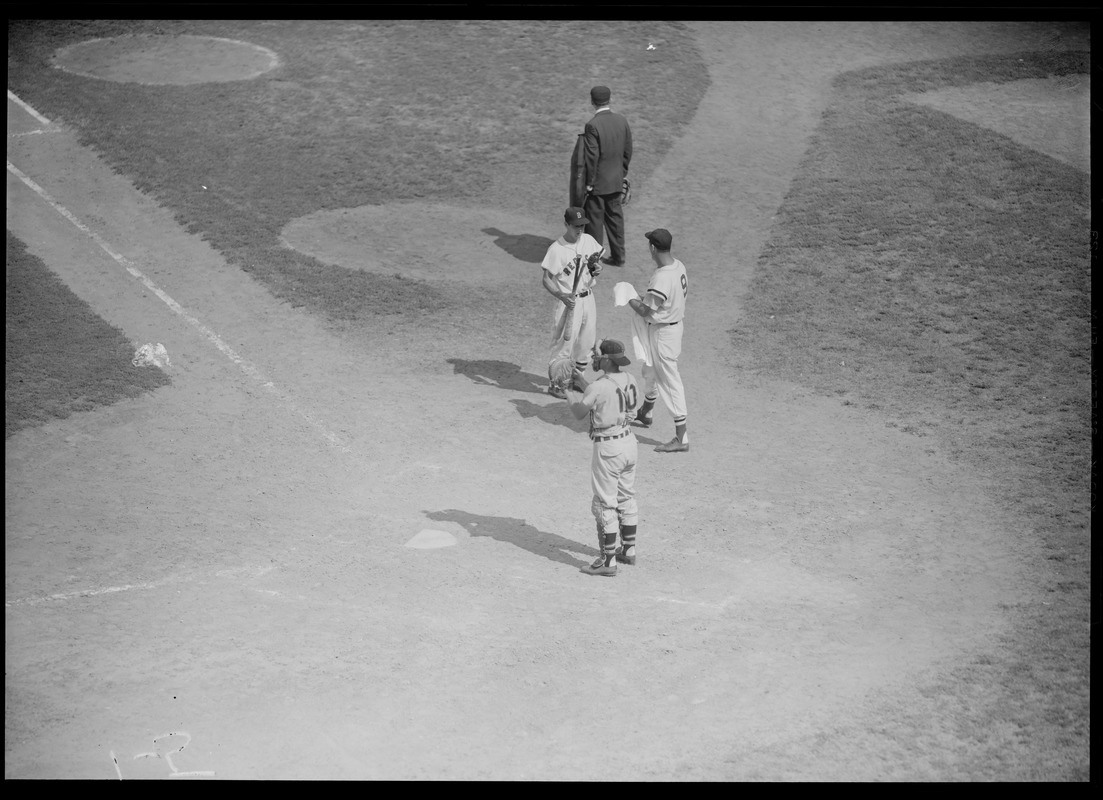 Bat boy visits Ted Williams at the plate