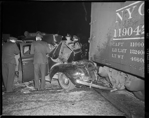 Auto hits freight car