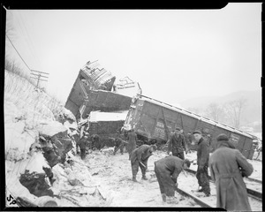 Possibly Boston & Maine RR along Deerfield River, Mass. One derailed car is a B&M outside braced box car, no. 72721