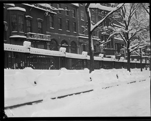 Fences in wintertime in front of State House and Boston Common