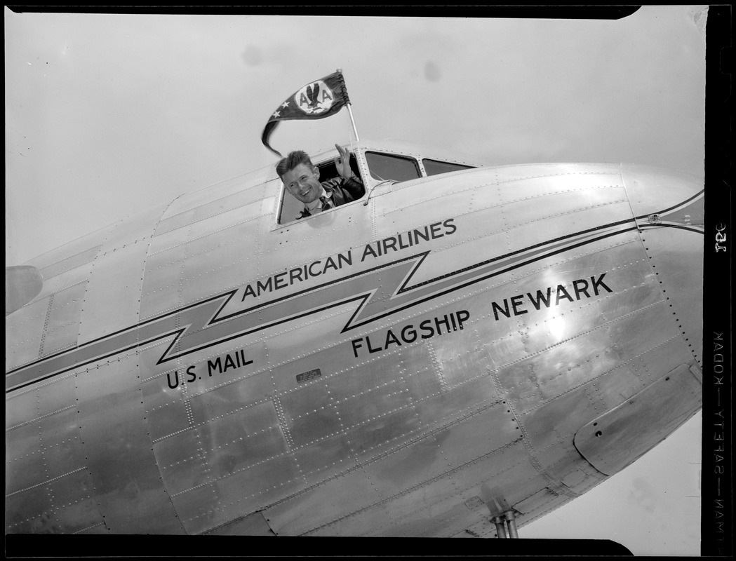 """""""Wrong Way"""" Corrigan waves from cockpit of American Airlines flagship Newark"""