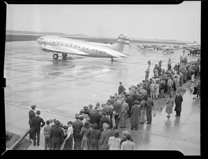 Crowd at airport with TWA passenger plane
