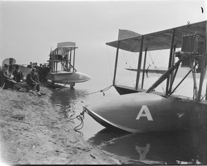 Curtiss flying boats on shore of Charles River