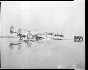 The Denmark, flagship of American Overseas Airlines, crash lands at East Boston airport