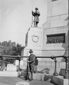 Militiaman guards Soldiers & Sailors monument, during police strike