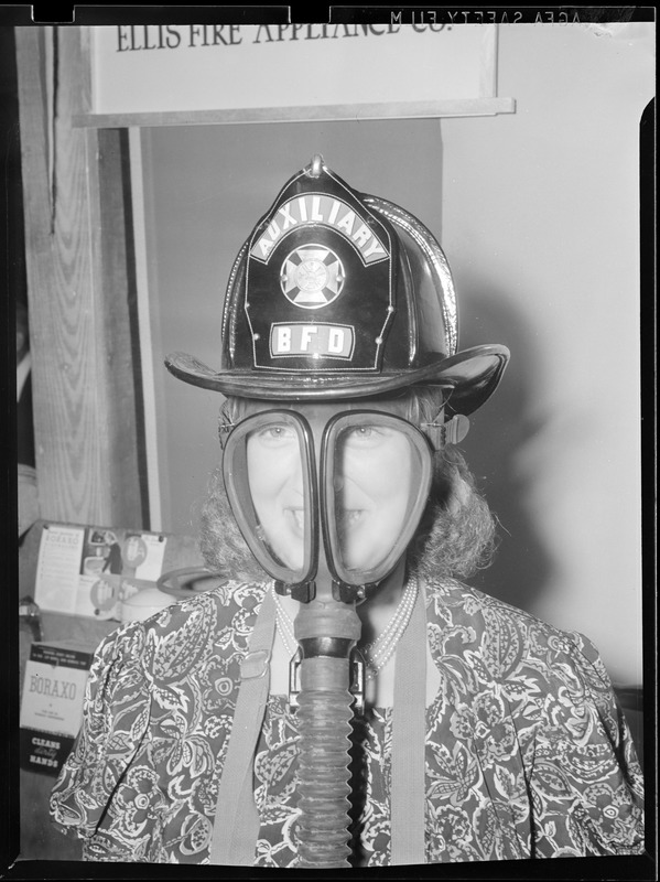 1 woman with mask & fire dept. hat on