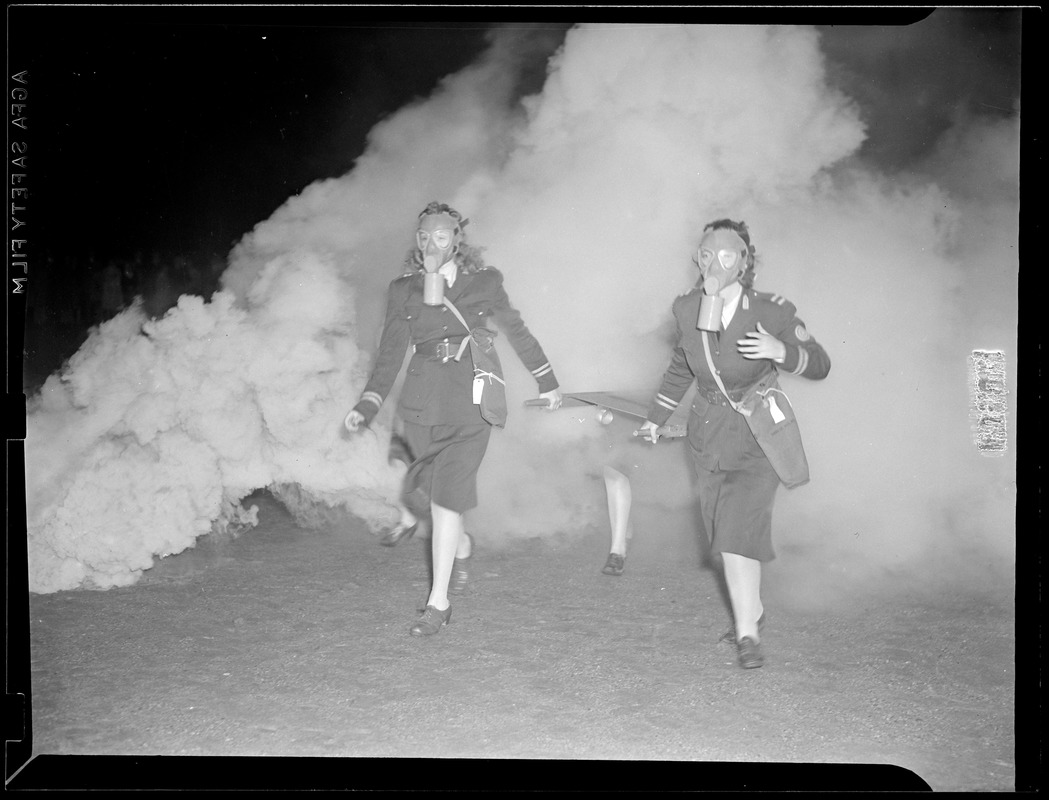2 women doing a fire drill with masks on