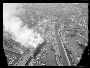 Aerial view of fire near Warren St. Bridge showing Charlestown city square