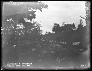 Distribution Department, Low Service Pipe Lines, Section 7, trench work, Ravine Road, station 582, from the northwest, Stoneham, Mass., Sep. 15, 1896