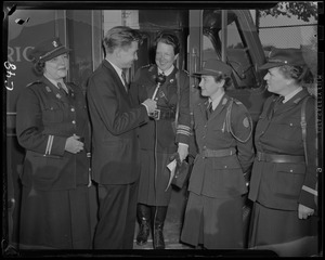 Jay Wesley of WEEI interviews Col. Natalie Hays Hammond with Capt. Mary A. Tucker and other members of the Civic Patrol of America