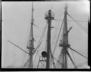 Two kinds of masts. Background: USS Constitution. Foreground: Lightship Nantucket