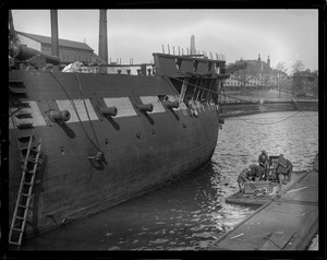 Navy Yard divers going down to take measurements of the hull of old frigate Constitution