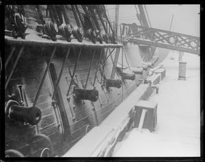 Snow covered frigate USS Constitution in Navy Yard