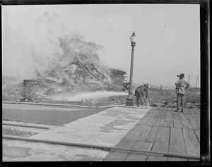 Burning decayed wood taken from USS Constitution during reconstruction