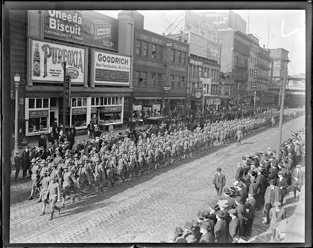 Eights Regiment arrives from the Mexican border. Parading near North Station, Canal St., Boston.