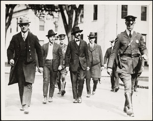 Sacco (2nd from left) and Vanzetti (with mustache) en route to court house, Oct 2, 1923