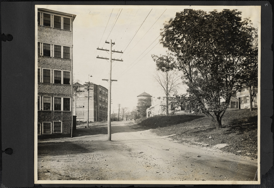 View looking west on Pearl Street toward railroad crossing showing section of Slater-Morrill Shoe Factory on left.