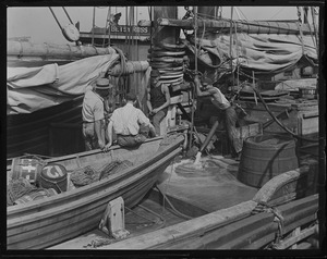 Trying to keep fishing schooner afloat at T-wharf