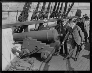 Secretary of Navy Wilbur inspecting guns of USS Constitution
