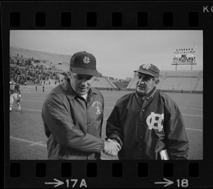 Boston College football coach Joe Yukica shakes hands with Holy Cross football coach Ed Doherty after game at Schaefer Stadium