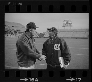 Boston College football coach Joe Yukica shakes hands with Holy Cross football coach Ed Doherty after a game at Schaefer Stadium
