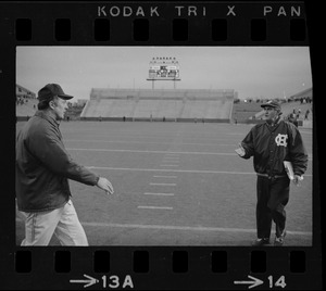 Boston College football coach Joe Yukica and Holy Cross football coach Ed Doherty reach out for a handshake after a game at Schaefer Stadium