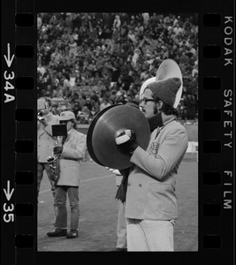 Band member playing cymbals during Boston College vs. Holy Cross football game at Schaefer Stadium