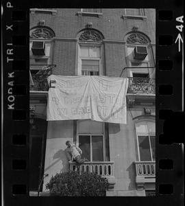 """Banner that reads """"Cambodia and 4 Murders in Ohio, Let's Stop It Now"""" hung outside 96 Beacon Street, Boston"""