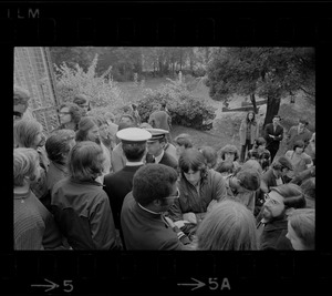 About 100 students block entry of Navy recruiters (white caps) into Alumni Hall at Boston College during protest against Vietnam war