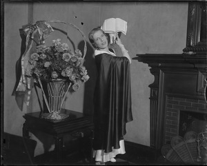 Aimee Semple McPherson, evangelist, posed with bible raised