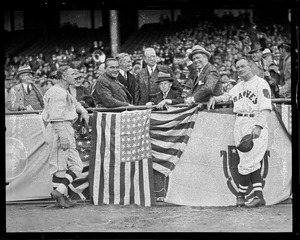 Joseph B. Ely throws out first ball at start of Braves season while judge Fuchs, Bill McKechnie, Frederick Mansfield and J.M. Curley look on.
