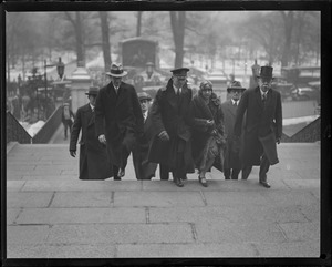 Capt. George Fried and wife going up the State House steps while in Boston