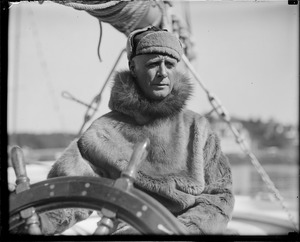 Donald B. MacMillan at the wheel of the ship Bowdoin he used in Labrador (14 months)