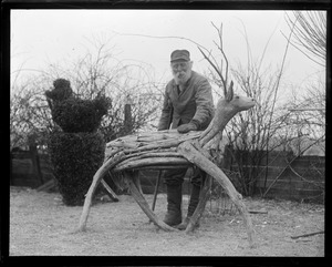 Wooden deer and George W. Kirby