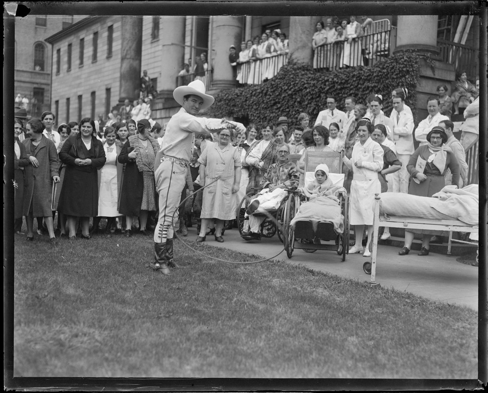 Tom Mix performs rope tricks for invalids at Mass. General