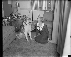 Actress Mary Pickford is visited in her dressing room on visit to Boston by a very big dog