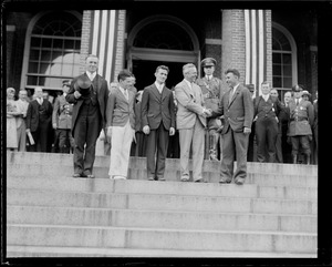 Group including James Curley and Joseph B. Ely on State House steps