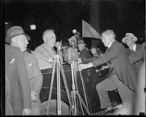 Curley adjusts microphone for Franklin Delano Roosevelt during campaign in Boston