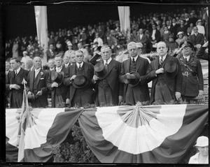 J.M. Curley and other dignitaries stand with doffed hats during anthem at ball game