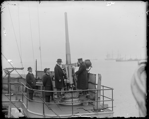 Gov. Coolidge and Mayor Peters inspecting famous anti aircraft gun on the USS Kentucky