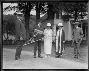 Cong. Treadway presents two rakes to Pres. Coolidge