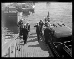 Pres. And Mrs. Coolidge landing at Plymouth, Mass. From launch that brought them in from outer harbor where Mayflower anchored.