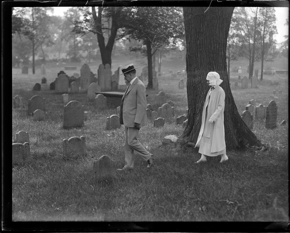 Pres. Coolidge and wife walking in cemetery