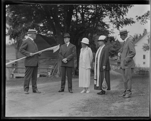 Cong. Allen J. Treadway presents Calvin Coolidge with two rakes, Plymouth, VT