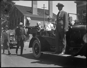 Pres. Harding waves from auto during procession in Plymouth