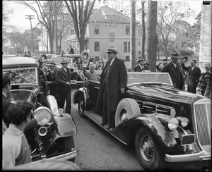 Franklin Delano Roosevelt waving his hat to the crowd from open auto during Boston visit