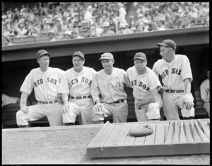 A's player poses with Red Sox players in dugout at Fenway (Lefty Grove to left; Jimmie Foxx second from right)