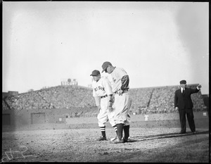 Joe Cronin of the Sox held on first by Lou Gehrig of the Yankees