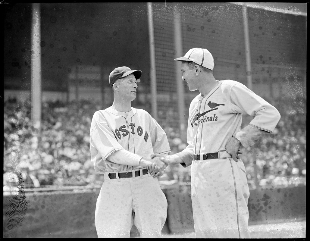 Lefty Grove of the Red Sox shakes hands with St. Louis Cardinal, Braves field